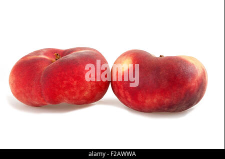 Two saturn peach isolated on white - Stock Photo