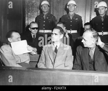 Nazi defendants under guard in the dock at Nuremberg War Crimes Trial, Feb. 5, 1946. L-R: Herman Goering covers - Stock Photo