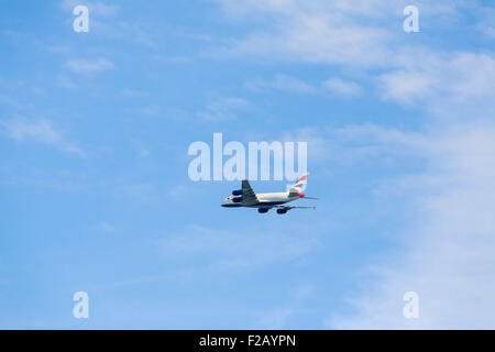 British Airways Airbus A380 flying over Windsor out of London Heathrow, England, UK - Stock Photo
