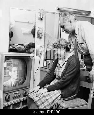 Helen Hayes and Charles MacArthur watch their adopted son Jamie MacArthur's television debut. The future star of - Stock Photo