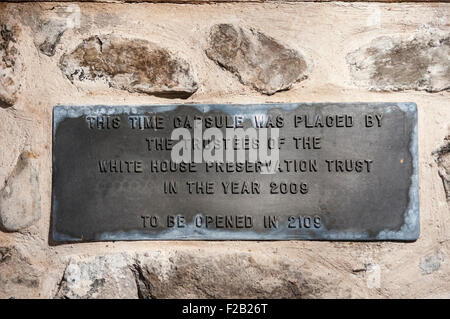 Cast iron plaque in the White House, County Antrim, advising that the time capsule behind should be opened in 2109. - Stock Photo