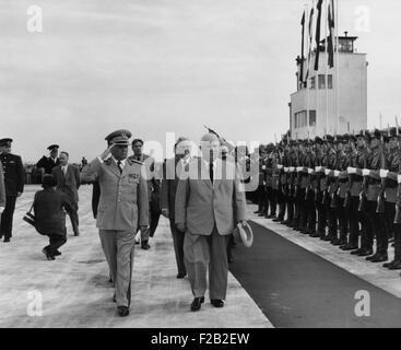 Nikita Khrushchev walks with Josip Tito, Yugoslav Communist leader in Belgrade, June 1955. Walking behind is Nikolai - Stock Photo