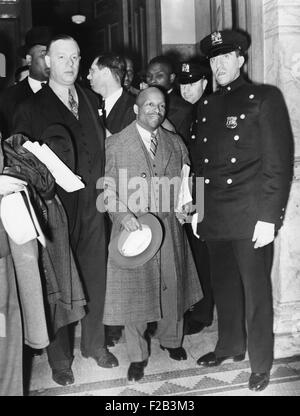 Guarded by a policeman, Father Divine, leaves Felony Court, NYC, April 30, 1937. Divine won a week's postponement - Stock Photo