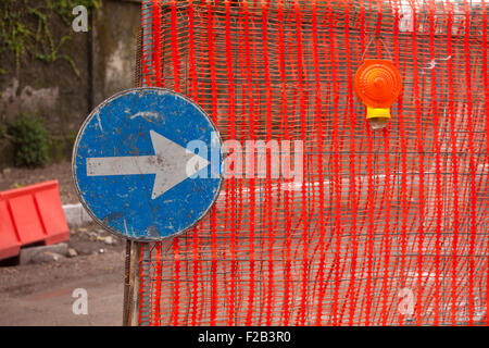 Blue Traffic Direction Signal on a construction site - Stock Photo