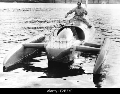 Donald Campbell sits astride his jet powered boat, Bluebird K7, on Lake Coniston. He will attempt to break his two - Stock Photo