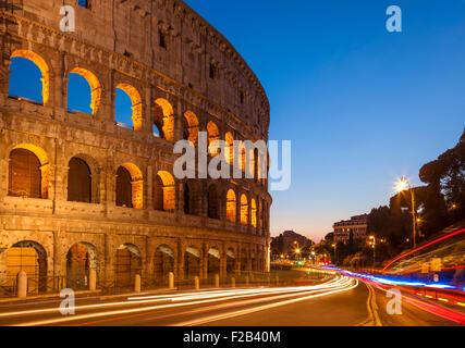 Rome Colosseum or Flavian Amphitheatre at night with light trails Rome Lazio Region Italy EU Europe - Stock Photo