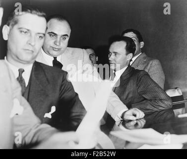 Al Capone, at the time of his indictment for tax evasion, June 5, 1931. At right is one of Capone's attorneys, Michael - Stock Photo