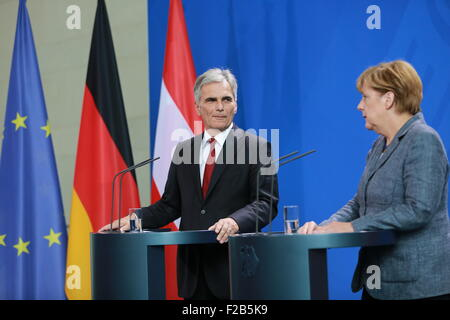Berlin, Germany. 15th Sep, 2015. Austrian Chancellor Werner Faymann (left) and German Chancellor Angela Merkel (right) - Stock Photo