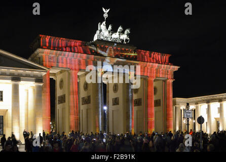 Colorfully illuminated Brandenburg Gate at dusk during the Festival of Lights, Mitte, Berlin, Berlin, Germany, Europe - Stock Photo