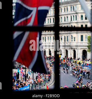 The Aviva Tour of Britain passes Trafalgar Square during the final stage of the 2015 race - Stock Photo