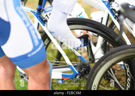 A cyclist from Team Novo Nordisk checks his tyre pressure before stage 7 of the Aviva Tour of Britain on 12 September - Stock Photo