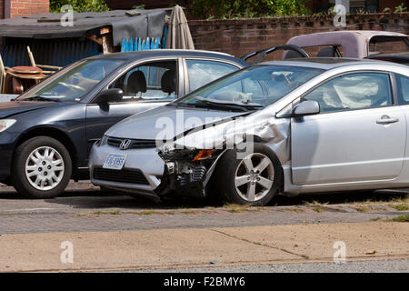 Car with front fender collision damage - USA - Stock Photo