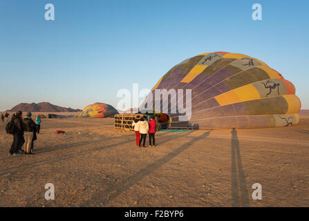 Preparing the hot-air balloons for take-off, at sunrise, Namib Desert, Kulala Wilderness Reserve, Namibia - Stock Photo