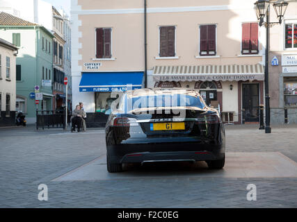 G1 registration plate Chief Minister official car Tesla Signature Model S , Gibraltar, British territory in southern - Stock Photo