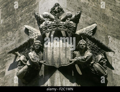Spain. Valencia. La Lonja. Corner depicting angels and Royal arms of Kingdom of Valencia. Sculpture. Gothic style. - Stock Photo