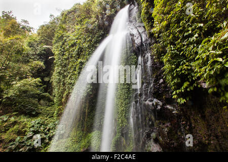 Jumog Waterfall located on the forested slopes of the dormant volcano of Gunung Lawu in central Java, Indonesia - Stock Photo