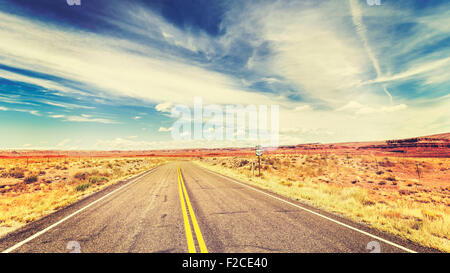 Retro vintage old film style endless country highway in USA, travel adventure concept. - Stock Photo