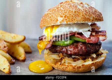 Beef burger with bacon and poached egg - Stock Photo