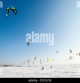 Kiteboarder with kite on the snow - Stock Photo