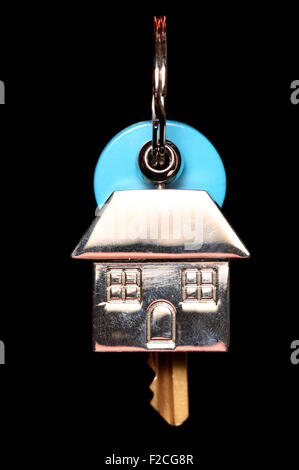 House keyring and key on black background - Stock Photo