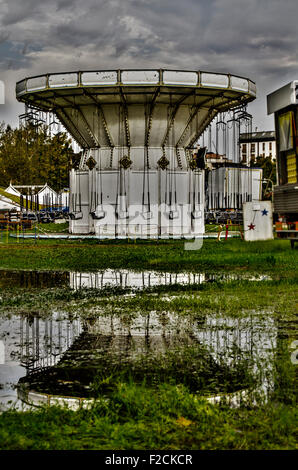 merry-go-round in the morning of closing, Vicenza, Italy - Stock Photo