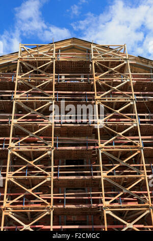 Scaffolding system for restoration of an old building. - Stock Photo