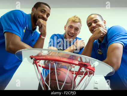 Berlin, Germany. 16th Sep, 2015. Players from the basketball team lba Berlin (r-l) Alex King, Niels Giffey and Jordan - Stock Photo