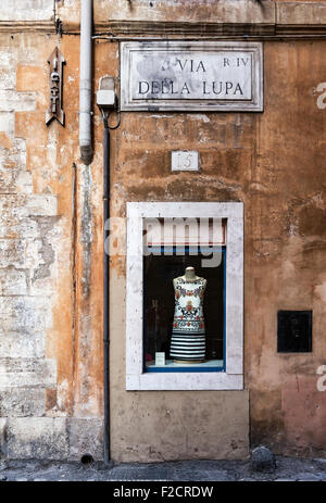 Dress shop window display on old street, Rome, Italy - Stock Photo