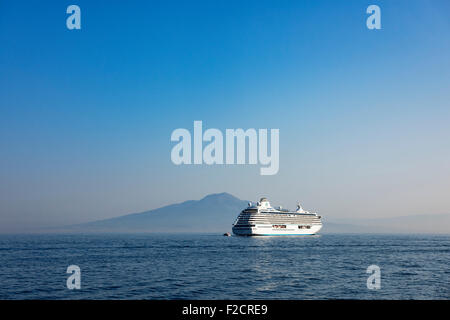 Cruise ship anchored on the Gulf of Naples with Mount Vesuvius in the background, Naples, Italy - Stock Photo