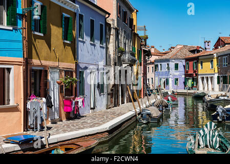 Colorful home facades in the Venetian fishing village island of Burano, Italy - Stock Photo