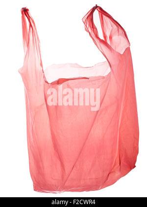 Empty pink plastic bag, back lit, floating - Stock Photo