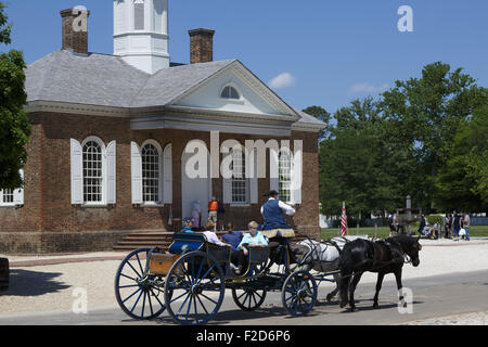 Horses and carriage takes tourists along Colonial Williamsburg living-history museum Virginia - Stock Photo