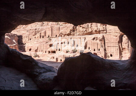 Outer Siq tombs framed by walls of a cave, Petra, Jordan - Stock Photo