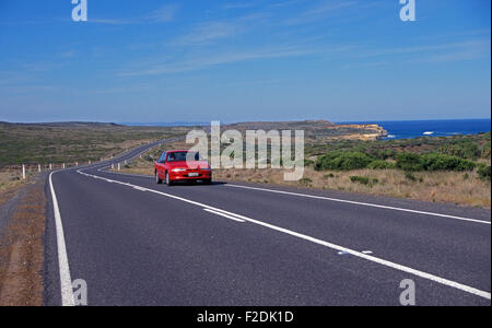 CAR TRAVELLING ALONG THE GREAT OCEAN ROAD, PORT CAMPBELL IN VICTORIA, AUSTRALIA - Stock Photo