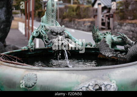 Copper green patina dragon fountain - Stock Photo