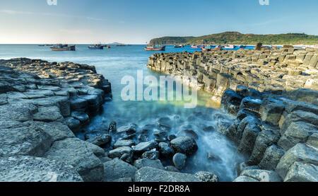 Exposure sea waves at dawn Giants Causeway - Stock Photo