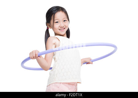 Happy girl spinning plastic hoop - Stock Photo