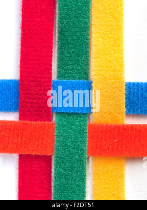 Colorful velcro strips braided together - Stock Photo