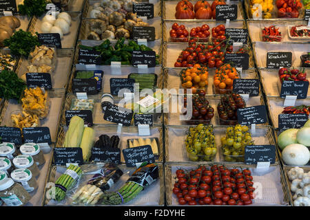 Various fruits and vegetables in a stall, Viktualienmarkt, Munich, Bavaria, Germany - Stock Photo