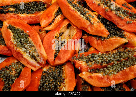 Slices of Papaya for sale in the market in Burma - Stock Photo