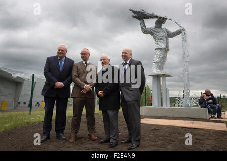 Artist Andy Scott (second left) with Terry Currie, Tommy Brennan and John Scott pictured at the official unveiling - Stock Photo