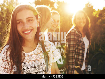 Portrait of group of friends, one smiling at camera - Stock Photo