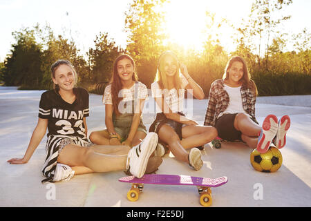 Portrait of friends on a summer day in a park - Stock Photo