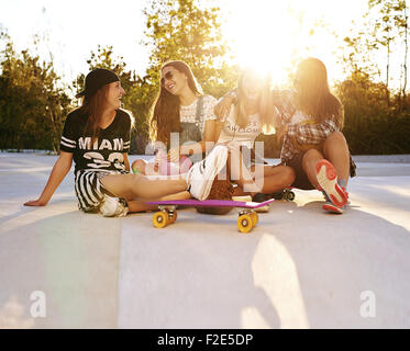 Best friends hanging out on the streets, summer and sunflare - Stock Photo