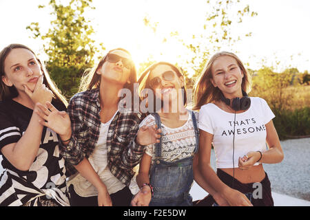Teenagers having fun on a summer day, sun flare - Stock Photo
