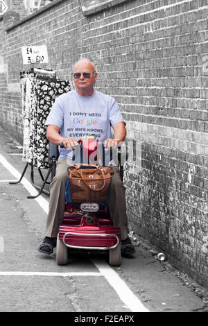 Man wearing I don't need Google my wife knows everything t-shirt on mobility scooter at Dorchester - Stock Photo