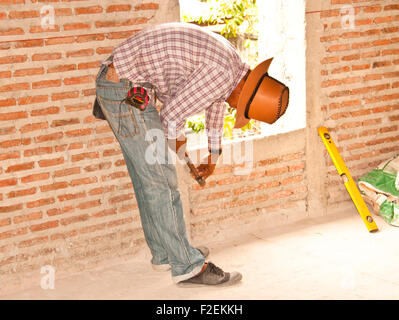 Construction workers are preparing a brick wall. - Stock Photo