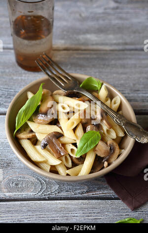 Pasta with champignons and greens, food - Stock Photo