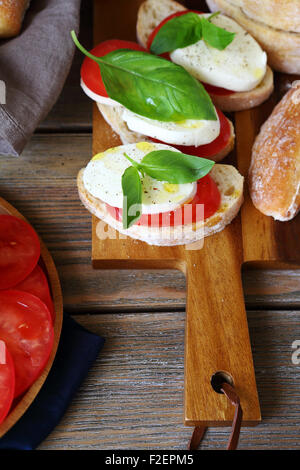 Cheese sandwich on a cutting board, food - Stock Photo