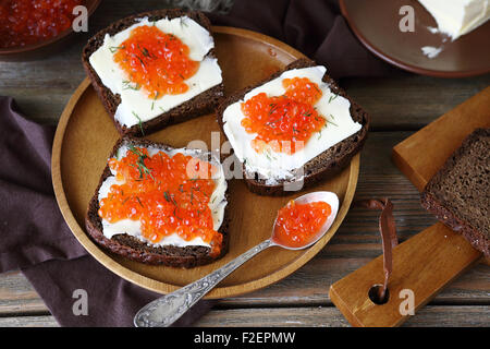 Delicious canapes with caviar on a plate, food - Stock Photo
